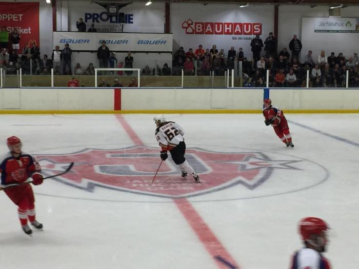 Hagelin skating at center ice.